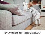 eleven months old baby girl... | Shutterstock . vector #589988600