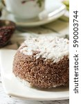 Small photo of Ragi Puttu - South Indian breakfast with Finger Millet and fresh coconut served with banana, selective focus