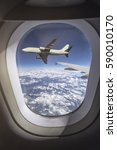 Small photo of airplane outside an airplane window during flight