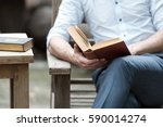 close up of a man reading a... | Shutterstock . vector #590014274