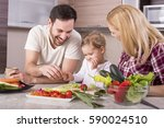 young couple with kid having... | Shutterstock . vector #590024510