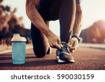 young male jogger athlete... | Shutterstock . vector #590030159