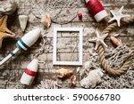 Styled composition with sea theme objects: fishing net, rope, buoy, float, starfish, shell, tackle, boat accessories on old wooden floor and white frame. Flatlay top view. Place for image or text.  - stock photo
