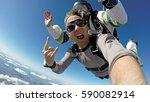 selfie skydiving tandem | Shutterstock . vector #590082914