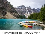 colorfuly rental canoes resting ... | Shutterstock . vector #590087444