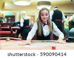 cute lady casino dealer at... | Shutterstock . vector #590090414