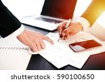 working day in office. two... | Shutterstock . vector #590100650