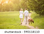 Stock photo happy couple future parents on the walk with the dog in the park 590118110