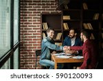 business partners shake hands... | Shutterstock . vector #590120093