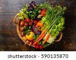 fresh vegetables in basket on... | Shutterstock . vector #590135870