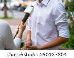 news journalist with microphone ... | Shutterstock . vector #590137304