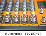 Small photo of sound engineer control panel with knobs and adjustment switches