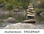 zen rock pile by mountain river | Shutterstock . vector #590189669