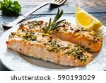 salmon roasted in an oven with... | Shutterstock . vector #590193029