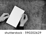 male hands holding a white... | Shutterstock . vector #590202629