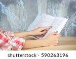 female hands holding opened... | Shutterstock . vector #590263196