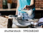woman pouring milk into the... | Shutterstock . vector #590268260