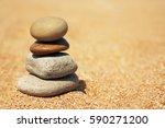 balanced stacked pebble stones... | Shutterstock . vector #590271200