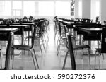 blurred rows of wooden tables... | Shutterstock . vector #590272376