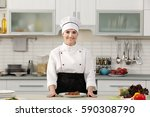 young woman with prepared meat... | Shutterstock . vector #590308790