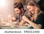 cute couple eating dinner | Shutterstock . vector #590311400