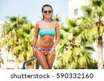 beautiful fit tanned sexy young ... | Shutterstock . vector #590332160