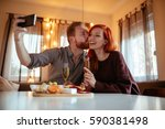happy ginger couple enjoying... | Shutterstock . vector #590381498
