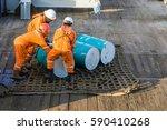 offshore workers handling...   Shutterstock . vector #590410268