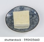 tofu on a colorful plate | Shutterstock . vector #590435660