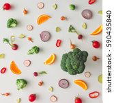 Small photo of Colorful food pattern made of broccoli, orange, red pepper, onion, tomatoes and lime. Flat lay.