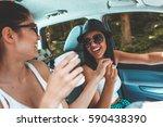 two young women hangout on car... | Shutterstock . vector #590438390
