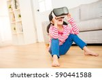 lifestyle shot of an amazed... | Shutterstock . vector #590441588