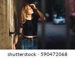 street style. beautiful woman... | Shutterstock . vector #590472068