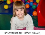 child in a playroom | Shutterstock . vector #590478134