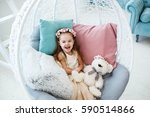 luaghing girl sits in round... | Shutterstock . vector #590514866
