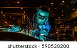 worker welding in a car factory ... | Shutterstock . vector #590520200