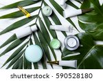 natural cosmetics and leaves on ... | Shutterstock . vector #590528180