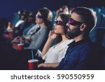 two friends watching movie in... | Shutterstock . vector #590550959