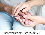young woman holding senior man... | Shutterstock . vector #590560178