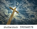 cross against the sky. easter.... | Shutterstock . vector #590568578