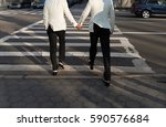 gay couple holding hands on... | Shutterstock . vector #590576684
