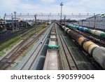 railway station. trains on the...   Shutterstock . vector #590599004