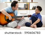 father and son sitting on sofa  ... | Shutterstock . vector #590606783
