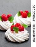 mini  pavlova meringue nests... | Shutterstock . vector #590627210