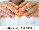 Cracking egg close-up - stock photo