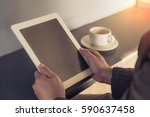 business man using tablet on... | Shutterstock . vector #590637458