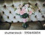 wedding bouquet bride is... | Shutterstock . vector #590640854