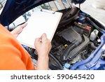 mechanic man holding clipboard... | Shutterstock . vector #590645420