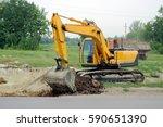 yellow excavator digging | Shutterstock . vector #590651390