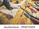 the carpenter works with wood... | Shutterstock . vector #590674304